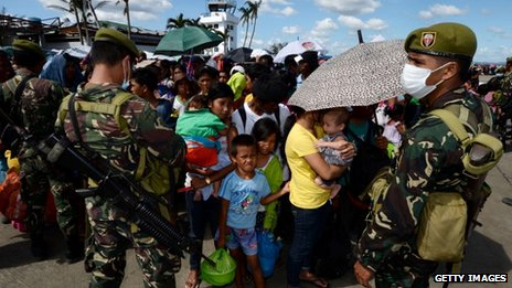 Philippine refugees wait for evacuation
