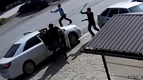 Men armed with a pistol, a machine-gun and a baseball bat