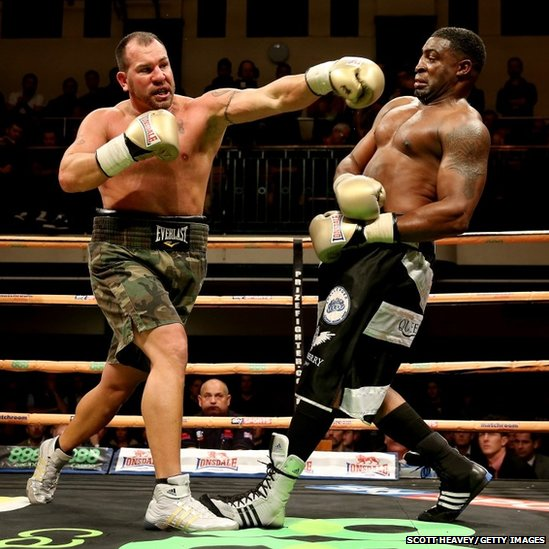 Jason Gavern of USA tries to land a punch on Michael Sprott of Great