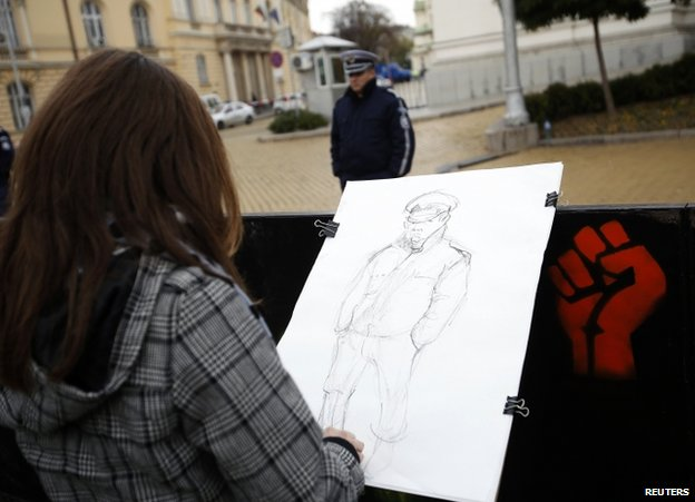 A student sketches a policeman during a protest in Sofia, Bulgaria 13 November