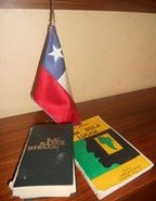A Chilean flag, a Bible and a book about communism