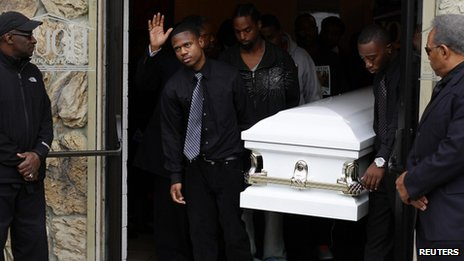 Pallbearers carried the casket of Renisha McBride during her funeral service in Detroit, Michigan on 8 November 2013