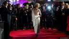 Actress Jennifer Lawrence arrives on the red carpet for the World Premiere of Hunger Games: Catching Fire, at a central London cinema