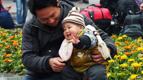 A Chinese man playing with his child at a park in Yichang, central China's Hubei province