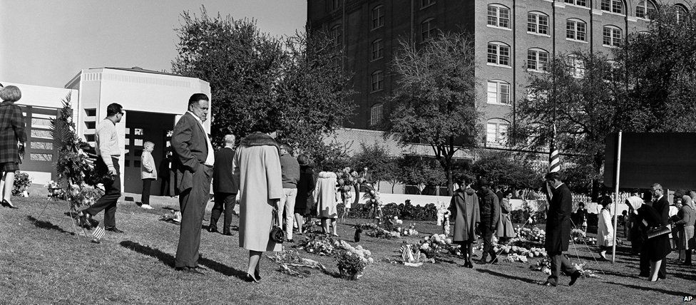 Crowds mourn outside the book depository