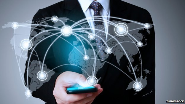 man in suit with smartphone and networking image