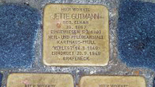 The Stolpersteine memorial stones embedded in a German pavement