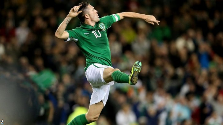Robbie Keane celebrates scoring for Ireland