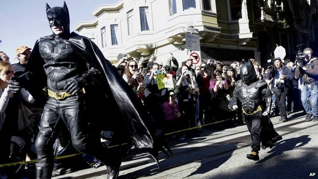 Miles Scott (right), walks with a man dressed as Batman in San Francisco, California on 15 November 2013