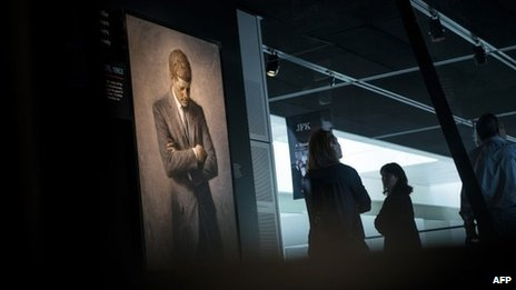 People view an exhibit about the 1963 JFK assassination at the Newseum in Washington DC 26 September 2013