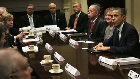 US President Barack Obama meets  health insurance industry leaders in the Roosevelt Room of the White House on 15 November 2013