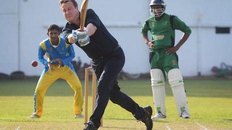 UK Prime Minister David Cameron playing cricket in Sri Lanka, 16 November 2013