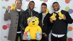 JLS, backstage, with Pudsey bears
