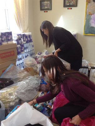 Staff sifting through donations at Philippines embassy in London