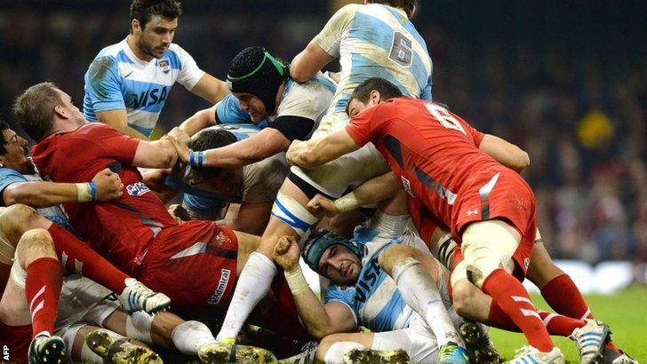 Wales and Argentina fight for the ball