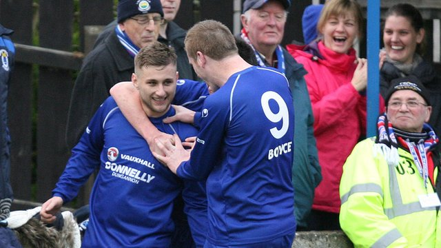 Jamie Douglas celebrates with Dungannon team-mates after scoring the winner against Linfield