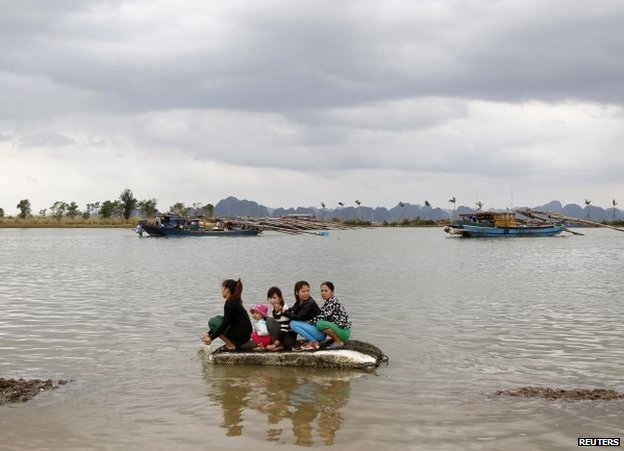 Evacuees in the north Vietnamese province of Quang Ninh, 11 November, after Tropical Storm Haiyan