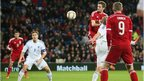 Andy King gets above his marker to give Wales the lead against Finland