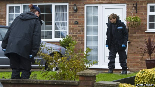 Police looking for evidence at the scene of the stabbing