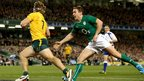Michael Hooper skips past Eoin Reddan of Ireland to score Australia's second try of the game