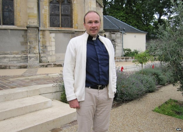 Fr Georges Vandenbeusch outside his church in Sceaux, south of Paris, 21 July 2011