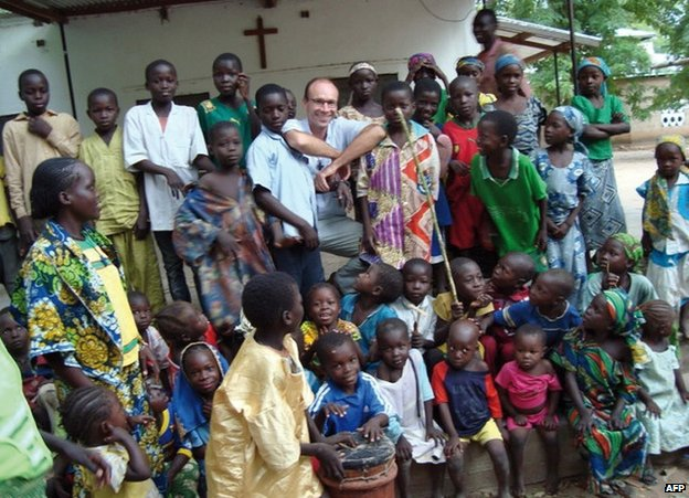 Fr Georges Vandenbeusch with children in Cameroon (image from 2012)