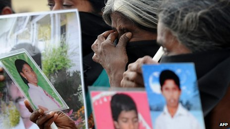"Sri Lankan Tamil mothers from the ""Dead and Missing Persons' Parents"" hold photgraphs during a protest in Jaffna, in northern Sri Lanka"