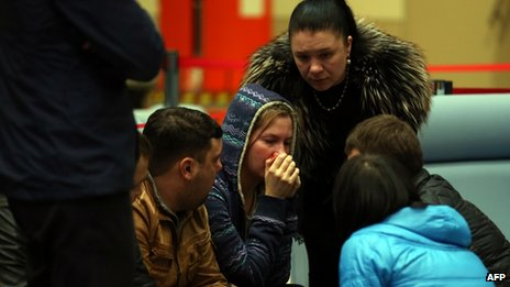 Relatives cry at Kazan airport. Photo: 17 November 2013