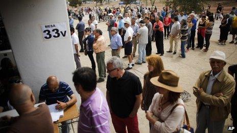 Chileans vote at the National Stadium in Santiago