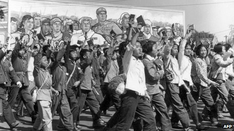 File photo: Chinese Red Guards, high school and university students, parade in Beijing's streets at the beginning of the Cultural Revolution, June 1966