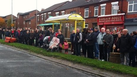 People line the streets of St Helens