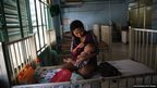 Joanne Vernen cares for her three month-old son Dwayne who is suffering from dehydration in Tacloban Hospital