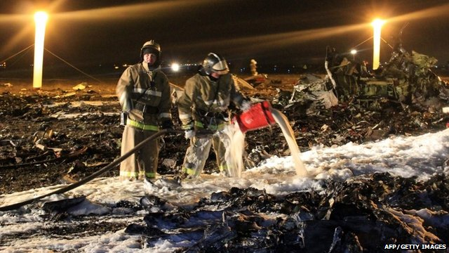 "Handout picture taken and released by Russia""s Emergency Ministry on November 17, 2013 shows the crash site of a Boeing 737 airplane at the airport of Kazan"