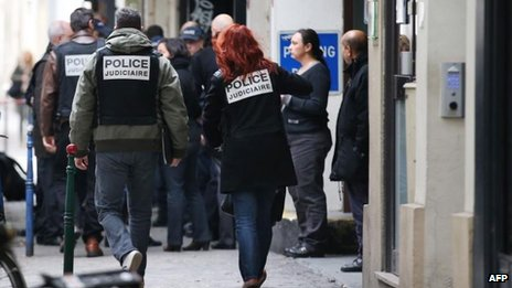 Police arriving at Liberation's Paris offices to investigate the shooting (18 November)