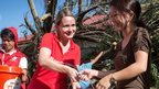 Cat Carter hands out aid in the Philippines