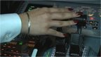 woman's hand on flight simulator controls