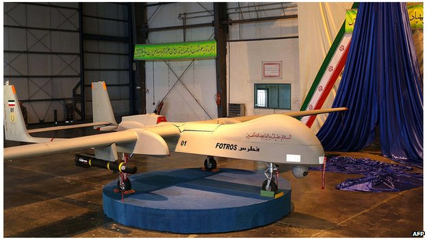 "An Iranian-made missile-equipped drone dubbed ""Fotros"", is unveiled in Tehran (18 November 2013)"