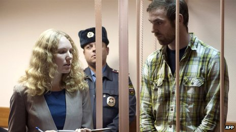 A handout picture released by Greenpeace shows British freelance videographer Kieron Bryan (R) attending a bail hearing in St Petersburg on November 18, 2013