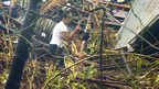 Survivors in Pawing, devastated by Typhoon Haiyan, in Leyte, central Philippines