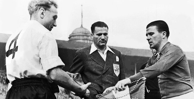 Billy Wright, left, and Ferenc Puskas, right, exchange pennants