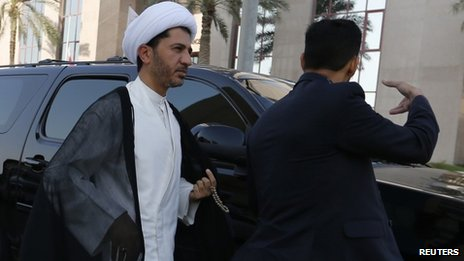 Ali Salman arrives at a police station in Bahrain for questioning (3 November 2013)