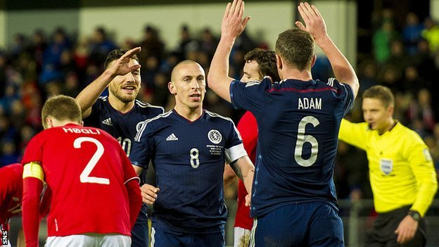 Scotland goalscorer Scott Brown is congratulated by Charlie Adam