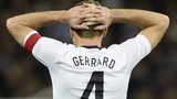 England captain Steven Gerrard reacts to Per Mertesacker's goal for Germany