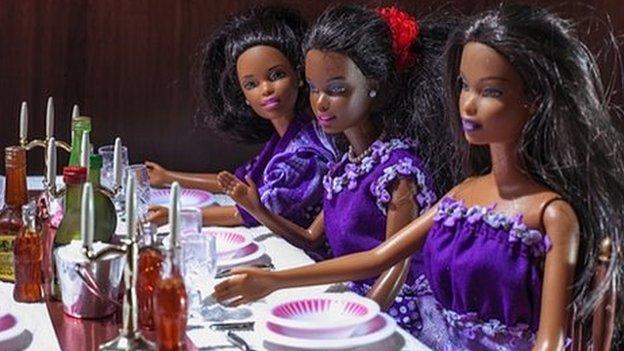 Barbie dolls having their wedding lunch