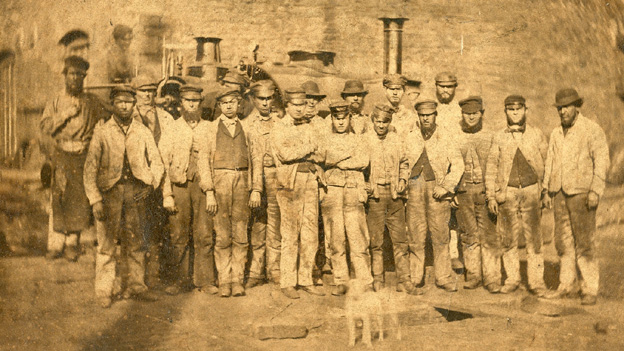 Neath Abbey Ironworks and workers, possibly taken around 1870. The engine in the background is works locomotive Plymouth
