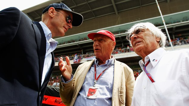 Donald Mackenzie (left) talks to former F1 World Champion Niki Lauda (centre) and F1 supremo Bernie Ecclestone