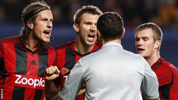 Angry Albion players Jonas Olsson, Gareth McAuley and Chris Brunt appeal to referee Andre Marriner over his decision to award Chelsea a penalty at Stamford Bridge