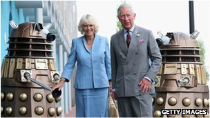 The Prince of Wales and Duchess of Cornwall and two Daleks