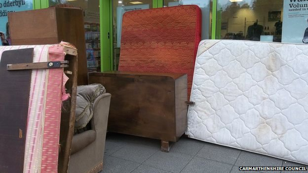 Unwanted items left outside the Barnardos shop in Ammanford