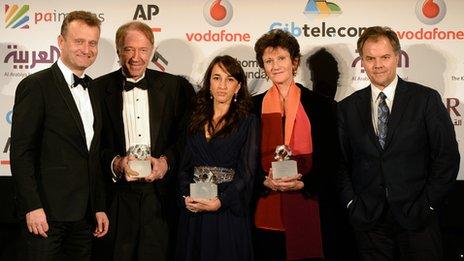 Hugh Dennis, Mike Thomson, Nina Manwaring, Bridget Harney and Matt Frei, who presented the team with the award